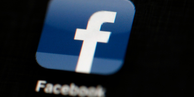 The majority of Facebook users react badly to videos appearing with sound when they're scrolling their Facebook feeds. Photo / AP