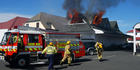 Russell volunteer firemen rushing into action at a fire in York Street, Russell. Photo / Rex Cooper, file photo