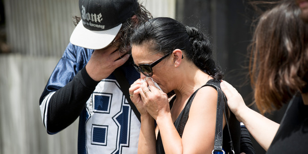 Jason and Esther Pakura at the scene on Rua Rd, New Lynn, Auckland, where their son Jacob Pakura, 16, was killed in a hit-and-run accident late on Saturday night. Photo / Dean Purcell