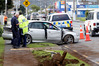 Officers examine the Subaru car Joshua Kite was allegedly driving when he crashed in Kamo Rd and allegedly fired a shot at pursuing police. Photo / John Stone