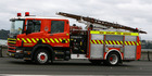 Fire crews were called to help free two people trapped following the crash. Photo / File
