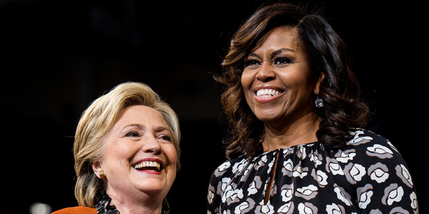Hillary Clinton and Michelle Obama. Photo / AP