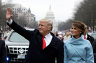 Donald Trump waves to supporters as he walks the parade route with first lady Melania Trump after being sworn in at the 58th Presidential Inauguration. Photo / Getty Images