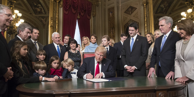 Trump is joined by the Congressional leadership and his family as he formally signs his cabinet nominations into law. Photo / Getty Images