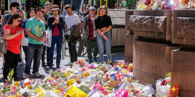 Mourners leave flowers and tributes to yesterday's victims on January 21, 2017 in Melbourne, Australia. Photo / Getty Images