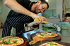 Chef Paolo Pancotti, of Dough Pizzeria, Napier, adds the finishing touches to a special Magherita pizza (the famous pizza that resembles the colours of the Italian flag), as part of International Day of Italian Cuisine. Photo / Warren Buckland