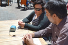 Lauren Tamehana and Alex Staric in the central city with the special device to measure second-hand smoke.