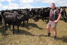 Okaihau farmer Terence Brocx with cows on his farm, waiting for decent rain to ease off the pressure on pasture. Photo / Peter de Graaf