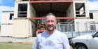 David Wade is building a house made out of twelve steel shipping containers.
