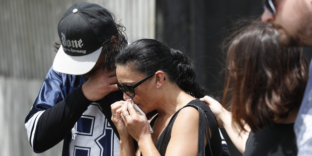 The parents of Jacob Pakura fight back tears during the blessing at the site where the 16-year-old died. Photo / Dean Purcell