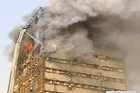 A historic high-rise building in the heart of Iran's capital caught fire and later collapsed on Thursday, killing at least 30 firefighters and leaving their stunned colleagues and bystanders weeping in the streets. Source: BBC