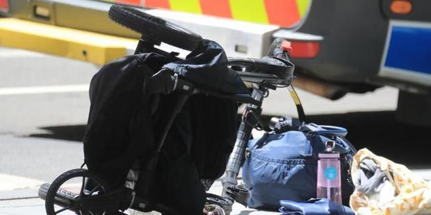 Loading A child was reportedly thrown out of the pram. Photo / News Corp Australia