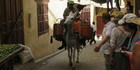 A heavily-laden donkey is ridden through the Fes medina. Photo / Justine Tyerman