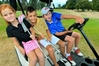 KIDS' PLAY: Millie Adsett, Cordell Henare and Zack Swanwick relish their time on the golf course even if it means pretending to drive and ride in a golf kart. PHOTO/Warren Buckland