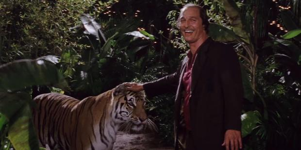 Matthew patting a tiger in a scene from Gold. Photo / YouTube