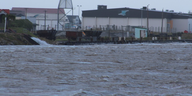 The Grey River at 7.30am, almost level with the old wharf. Photo / Greymouth Star