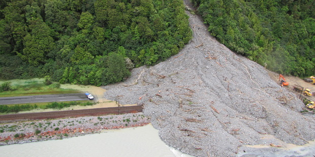 The massive slip blocking State Highway 73 between Jacksons and Aickens, spilling into the Taramakau River. Photo / Supplied