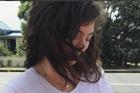 Lorde holding her new godson. Photo / Instagram