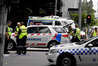 Police and rescue vehicles are parked after a car struck pedestrians in the central business district of Melbourne. Photo / AP