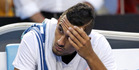 Australia's Nick Kyrgios sits in his chair after losing the third set against Italy's Andreas Seppi. Photo / AP