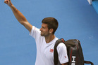 Novak Djokovic waves and leaves Rod Laver Arena after losing to Uzbekistan's Denis Istomin during their second round match at the Australian Open. Photo / AP