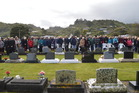The crowd at the Karoro Lawn Cemetery this morning for the minute's silence at 10.04am, exactly 50 years on from the Strongman Mine disaster that claimed the lives of 19 men. Photo / Greymouth StarHerald Archives