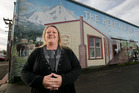 South Taranaki District councillor Steffy Mackay, pictured in front of a mural depicting the history of the Taranaki settlement of Eltham. She wants to see more government funding. Photo / Alan Gibson