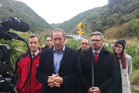 Kieran McAnulty, left, the Wairarapa Labour candidate, and Labour Party deputy leader Jacinda Ardern, with leader Andrew Little at the entrance to the Manawatu Gorge