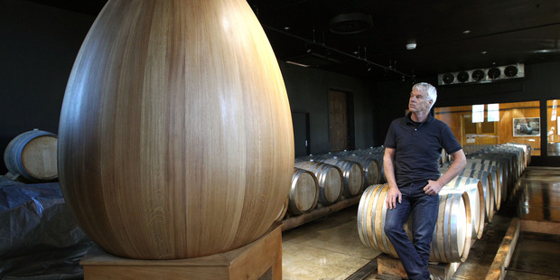 Winemaker Tony Bish with the great French oak ovum - a feature piece of the Ahuriri winery's impressive barrel room. Photo/Duncan Brown