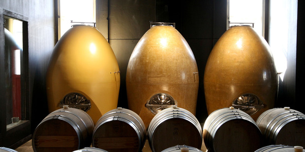 The three great concrete egg vats in the urban winery's brand new barrel room.  Photo/Duncan Brown