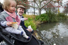 Isaac French and 1-year-old daughter Francesca French of Hastings feed the ducks at Cornwall Park, Hastings. Photo Warren Buckland
