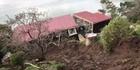 Watch: Otago cottage 'split in two' after mud torrent