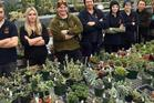Horticulture apprentices (from left) Morgan Hampton, Stephanie Sinton, Carla de Boer, Jacqui Skelton, Kyla Mathewson, Briar Alexander, French horticultural student Camille Couteau, and Toni Robertshaw in the Dunedin Botanic Garden's propagation house. Photo / Stephen Jaquiery