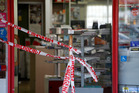 Emergency police tape stops customers from going inside  Kensington Stationers after a robbery. Photo/Michael Cunningham