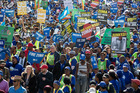 Protesters against President Jacob Zuma, march to parliament in Cape Town yesterday before the vote. Photo / AP