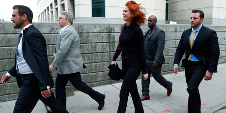 Tree Paine, centre, publicist for pop singer Taylor Swift, is surrounded by security as she leaves the civil trial for the singer. Photo / AP