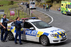 Police cordon off the intersection of Mt Tiger Rd and Whareora Rd shortly after the shooting two weeks ago. PHOTO/JOHN STONE