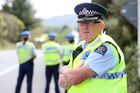 Inspector Wayne Ewers carries out a speed sting at Kauri, part-way along a stretch of Northland road which has been identified as one of NZ's most dangerous state highways. Photo/Michael Cunningham