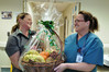 Countdown Hastings assistant store manager Philippa Reston, left, presents one of the gift baskets to Emergency Department nurse co-ordinator Sue Revell.  Photo / Warren Buckland