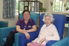 Juliet Garcia, pictured with resident Kathleen Bowater, is feeling more secure in the job she loves at Switzer Residential Care. Photo / Peter Jackson