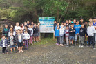 Whangaruru School pupils in front of the newly erected signs they hope will stop rubbish dumping. Photo/Supplied