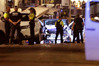 Police officers stand next to the van involved on an attack in La Rablas in Barcelona, Spain. Photo / AP