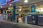 Offenders drove a white Nissan Pulsar stationwagon through the doors of Caltex Dinsdale overnight. Photo / Belinda Feek