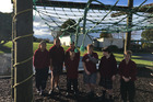 St Patrick's School students can't play on their cargo net because vandals cut it up