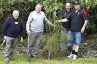 Sir Colin Meads planting a tree to commemorate the Ohaupo RFC 125th jubilee in 2013 with Brian Matthews, Peter Bloodworth and Rod Fisher.