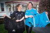 Cranford Hospice medical officer Sophie Duckworth (left) and marketing and fundraising manager Nathalie van Dort holding some of the gear to be auctioned on Friday. Photo/ Warren Buckland.