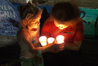 Willow Bailey, 6, and Parekaarewa Huata, 11, holding candles at the 'Vigil for Water' in Havelock North last night. Photo/Ruby Harfield