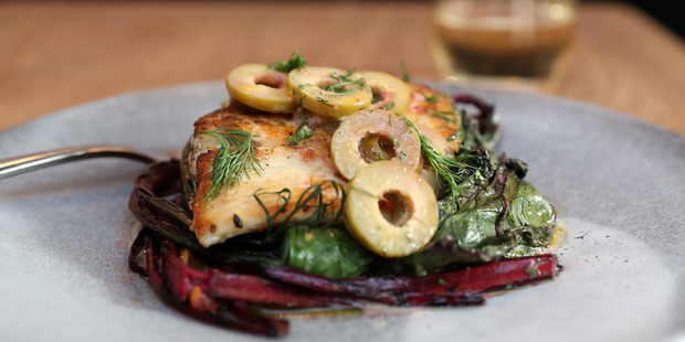 The market fish with chard, anchovy and olives at Hugo's Bistro. Photo / Getty Images