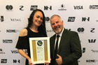 INVESTMENT PAY-OFF: Spark Whanganui owner Shane Nottage and retail manager Nika Letufuga with their Retail NZ Top Shop runner-up award for 'investment in people'.