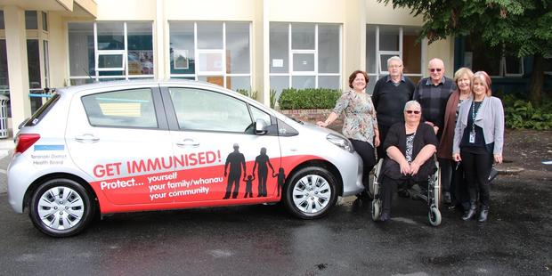 Ethel Gray Charitable Trust trustees Mary Stanley, Doug Hutchinson, Shirley Hazlewood, Barrie Smith, Barbara Williams with Melanie Hurliman, co-ordinator for vaccinations at the TDHB and a co-opted member of the trust along with the newly signwritten car.